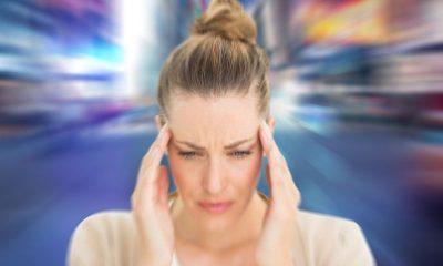 bigstock-Woman-with-headache-against-bl-82416035