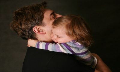 The small daughter embraces the father